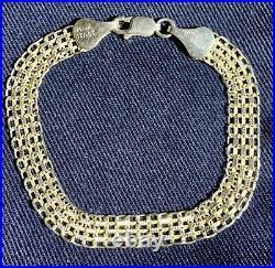 10 K solid gold bracelet 1/4 wide, length 7