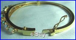 14K Gold & Opal Hinged Bangle Bracelet 17.7 grams 19 opals 1/2 wide