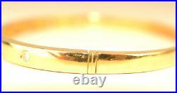 14K YELLOW GOLD 7 DIAMOND 3/16 WIDE HINGED BANGLE BRACELET. 21 CARAT TW 16.9 g