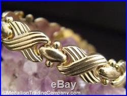 14K Yellow Gold X O Hugs Kisses Infinity Link 10mm Wide Stampato Bracelet 7.25