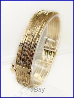 14k Yellow Gold Semanario Bangles (Set of 7), 18.8 g, 1.8mm wide, 67mm diameter