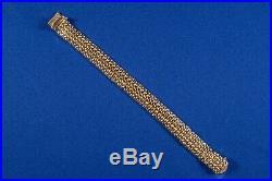 18K yellow gold mesh bracelet, 8 long, 0.5 wide. Flexible, but bangle like