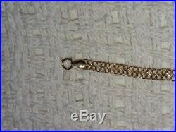 Solid 14k gold figure 8/infinity style bracelet. 8'' long. 5 mm wide. 2.2 grams