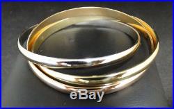 Trinity De Cartier 18 Karat Gold Tricolor Rolling Bracelet 5 mm Wide 6 Wrist